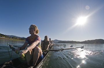 Student crew team members enjoy some sun while rowing on Lake Casitas, which held the 1984 Olympic rowing and kayaking events. Photo courtesy of Rich Reid.·