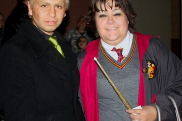 Harry Potter fans Horacio Sanchez and Laura Harris pose in their Potter-themed costumes outside of the Harry Potter and the Deathly Hallows midnight showing. Credit: Geneva Douma/The Foothill Dragon Press.