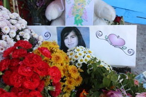 Family and friends have left flowers outside Alaina Stockdill's home where she was allegedly murdered by her mother. Photo and slideshow by Sobeida Curiel/The Foothill Dragon Press.