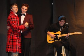 Juniors Nate Rowley and Jackson Tovar dance while junior Steven Mariani plays the guitar. All three competed in last night's Mr. Foothill competition. Credit: Felicia Perez/The Foothill Dragon Press.