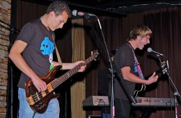 Seniors True Randall and Bill Grundler play bass and guitar, respectively, for the local student band, The Rhine. Credit: Alex Phelps.