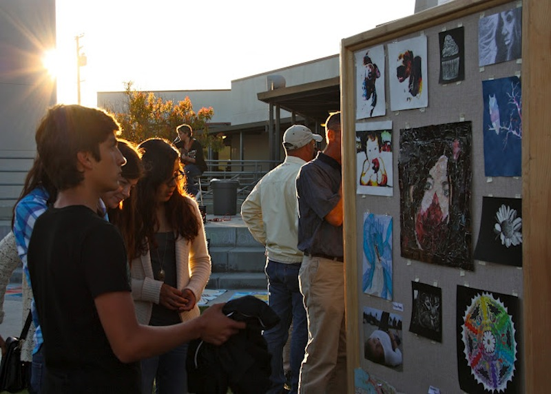 Foothill sophomores Angel Mayorga (far left), Victoria Bonds (second from left), and Sarah Reyes (far right) stand with Ventura sophomore Tess Tait (second from right) and look at the pieces submitted to Foothill's annual art show. Credit: Anaika Miller/The Foothill Dragon Press