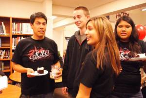 Math instructor Anthony Villa helps pass out cake during celebration. Photo: Alison English/The Foothill Dragon Press.