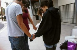 Participants in See You At the Pole join hands at Foothill to pray. Photo by Caitlin Trude of The Foothill Dragon Press.