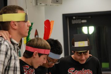 From left, seniors Chris Hanna, Wesley Harris, David Choi, and Ryan Harris participate in the activities at the senior Thanksgiving potluck on Friday. Credit: Josh Ren/The Foothill Dragon Press