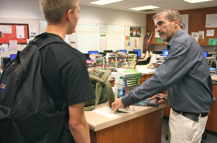 Author Andrew Smith talks to freshman Brian Yuss Wednesday after he spoke to Kirsten Faulconer's EDA class. Credit: Megan Kearney