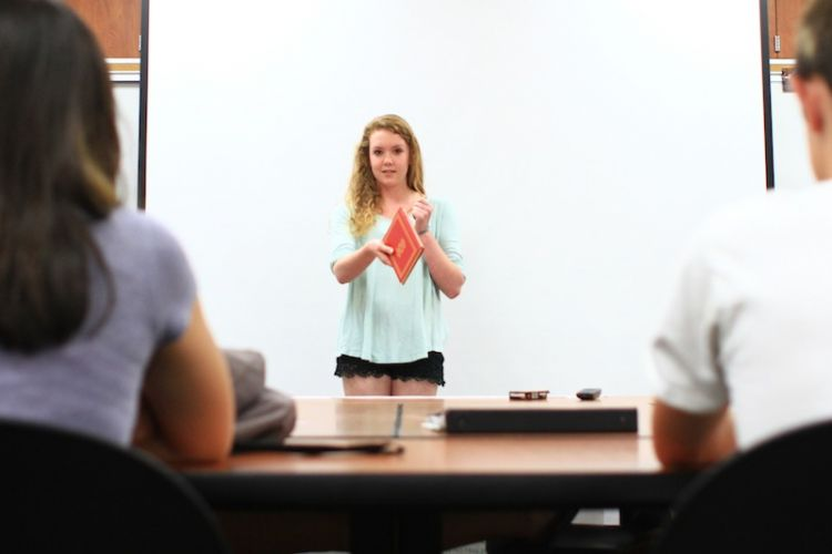 Senior Bryn Gallagher gives her Dragon Talk presentation to a classroom filled with attentive students. Credit: Aysen Tan/ The Foothill Dragon Press