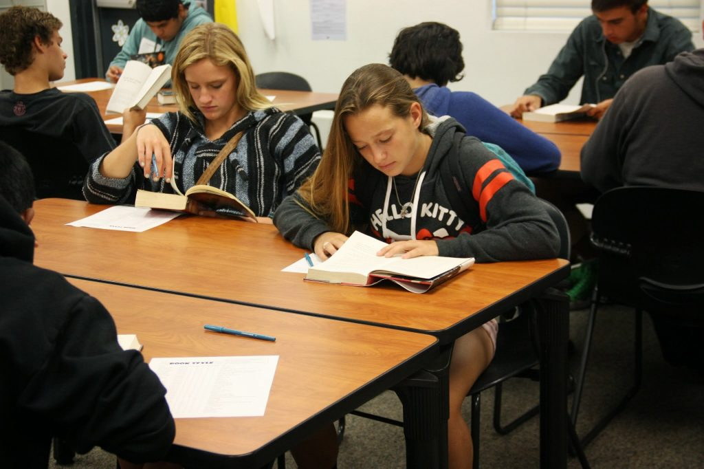 """Freshmen Lezly Plahn (left) and Brianna Graham (right) begin to read their books for the """"Angel Potato Revolution."""" Credit: Megan Kearney/The Foothill Dragon Press"""