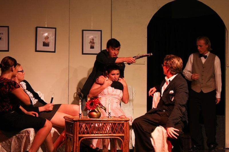 Junior Judah Olsen and senior Hailey Tallman (center) were actors in