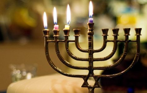 A menorah is lit as part of the Hanukkah celebration. Flickr Creative Commons Credit: David Goehring