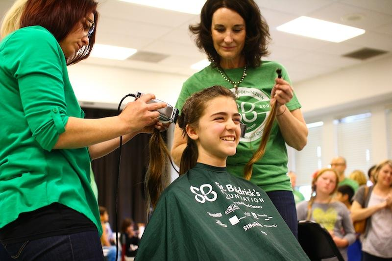 Freshman Courtney Corbett shaves off her hair. Credit: Aysen Tan/The Foothill Dragon Press