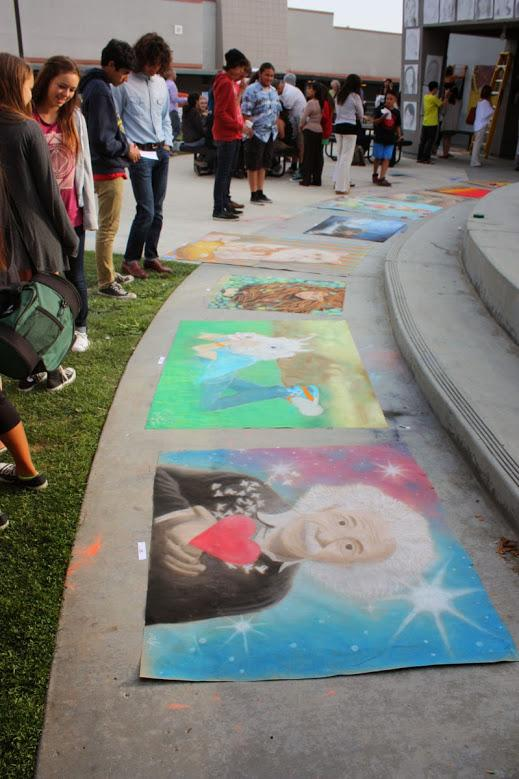 Students and community members observed the chalk drawings finished that afternoon. Credit: Maddy Schmitt/The Foothill Dragon Press