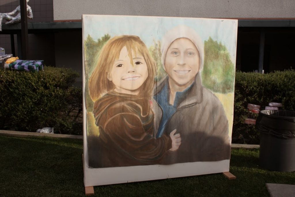Portraits of deceased former Foothill teacher Chris Prewitt were sold to make money for the Fund. Credit: Maddy Schmitt/The Foohtill Dragon Press