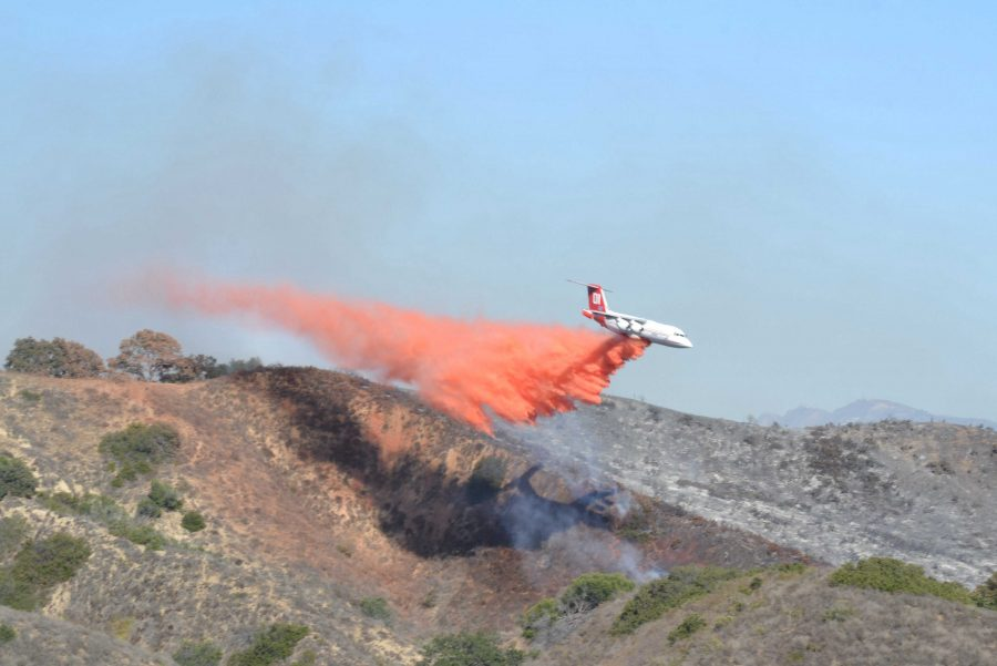 Multiple aerial firefighters combat the