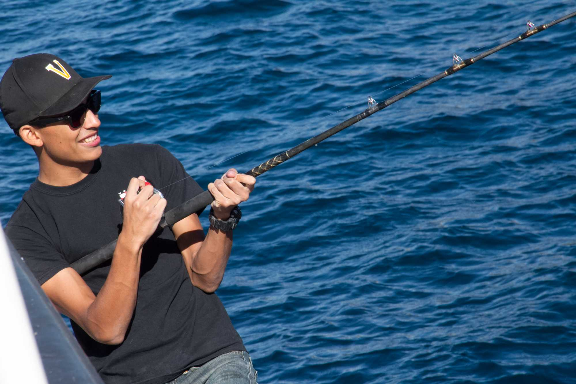 Senior and BioScience member Carlos Cohen reeling in his catch, November 24, 2014. Credit: Johnathan Carriger/The Foothill Dragon Press