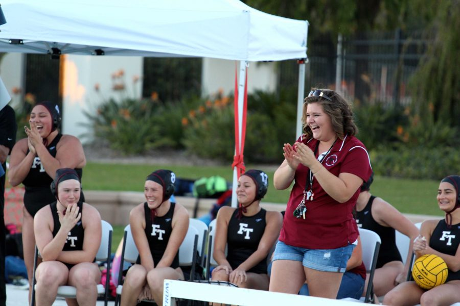 Coach+Samantha+Ebberson+%28standing%29+laughs+with+Foothill+Technology%27s+inaugural+girl%27s+water+polo+team.+Credit%3A+Kazu+Koba%2FThe+Foothill+Dragon+Press