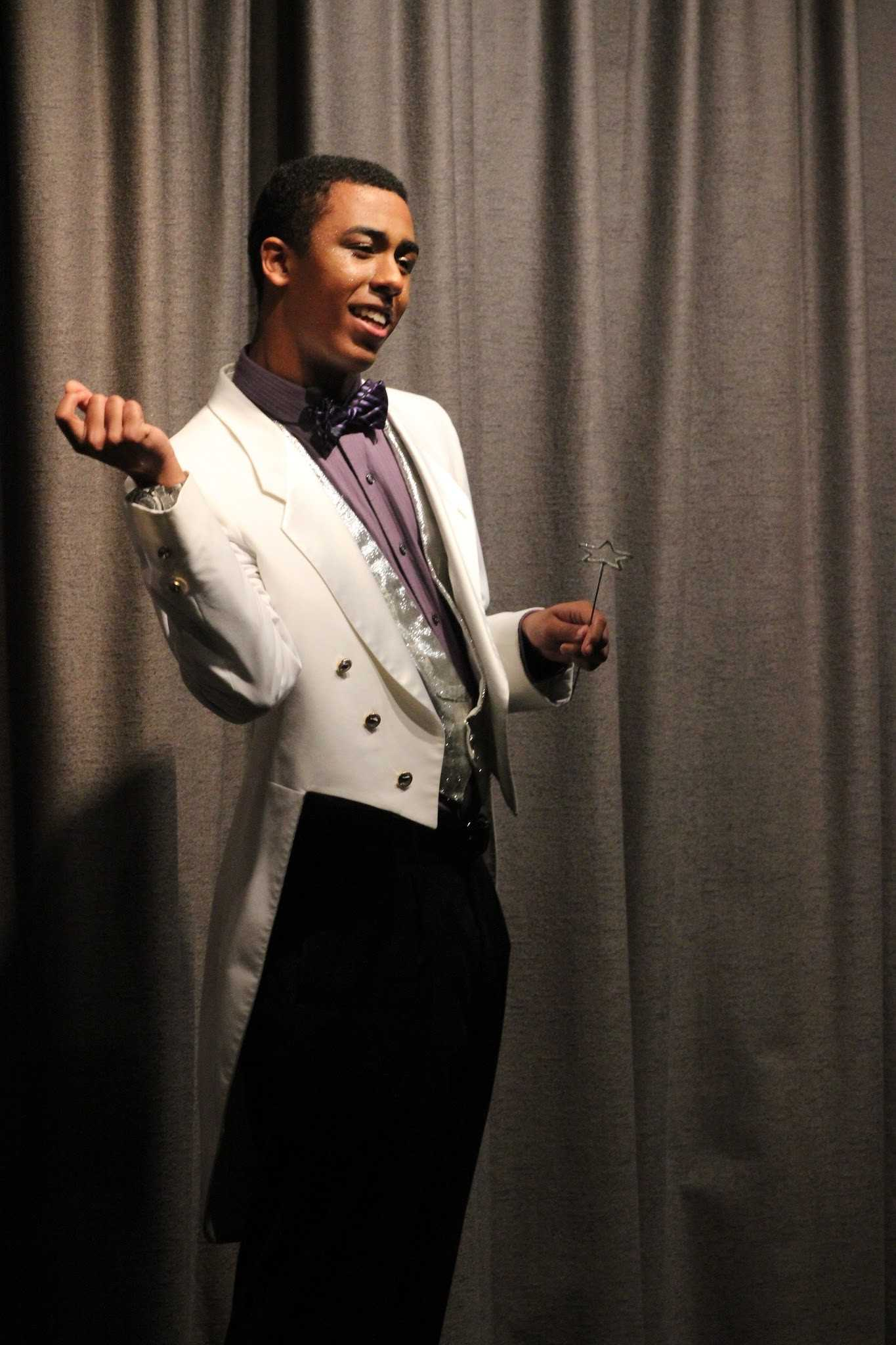 """Senior Aaaron Hooks playing the """"sassy"""" fairy godfather in Foothill's production of """"Beauty is a Beast."""" Credit: Rachel Horiuchi/The Foothill Dragon Press"""