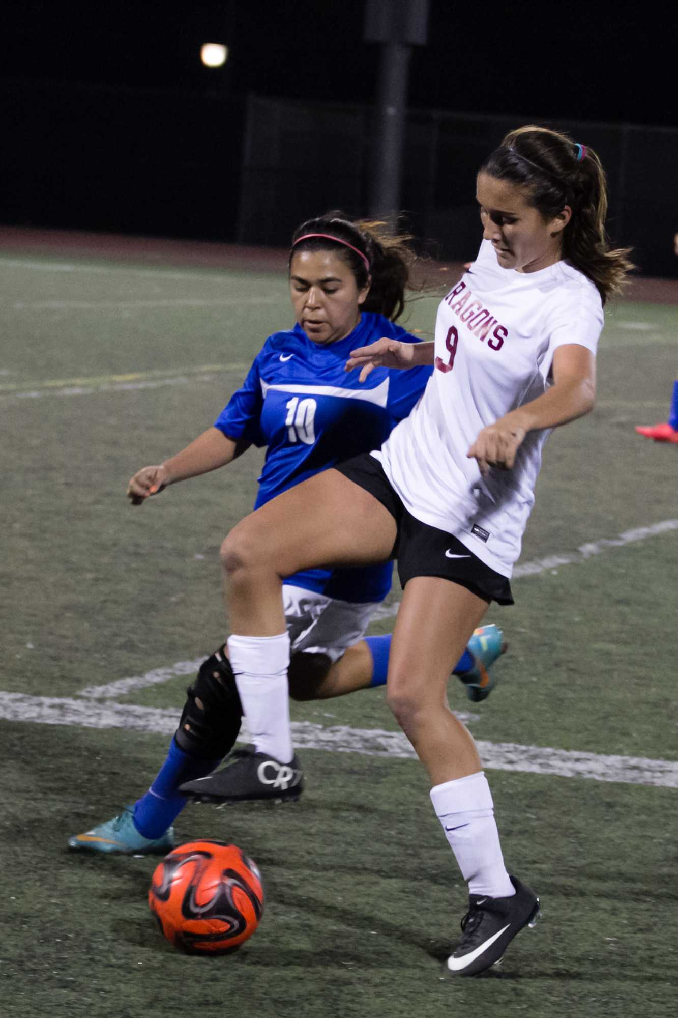 Freshman Olivia Morales fights over the ball. Credit: Josh Ren/The Foothill Dragon Press