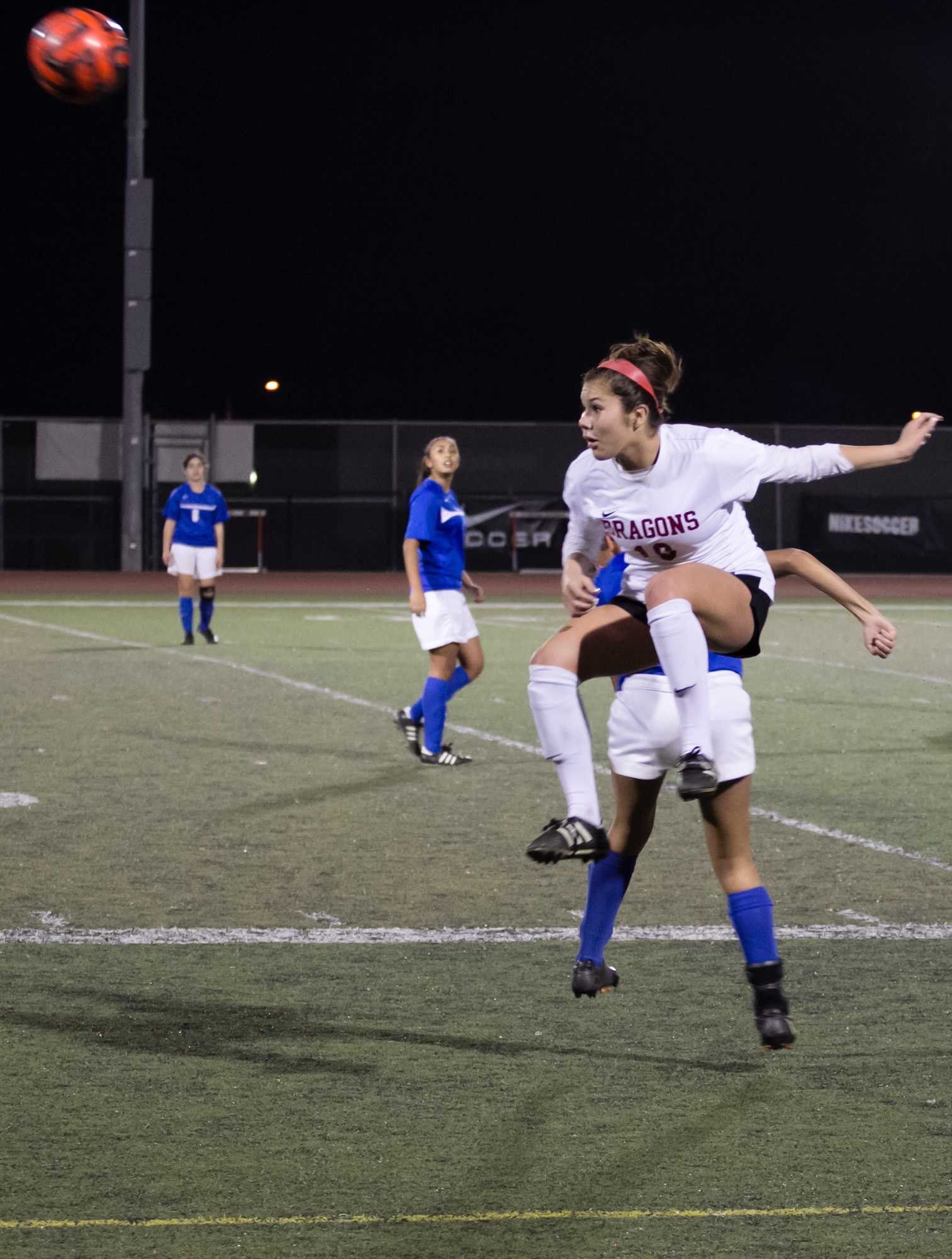 Senior Josselyne Pereda hearts the ball away from the opponent's side. Credit: Josh Ren/The Foothill Dragon Press