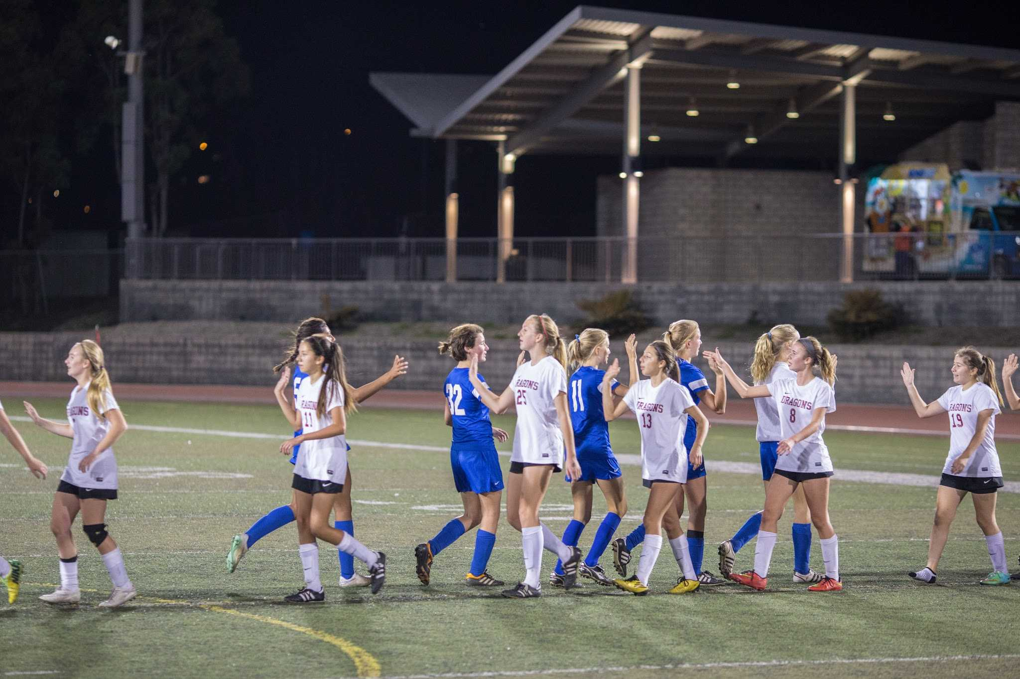 Both teams high five after the game. Credit: Austin Hunt/ The Foothill Dragon Press