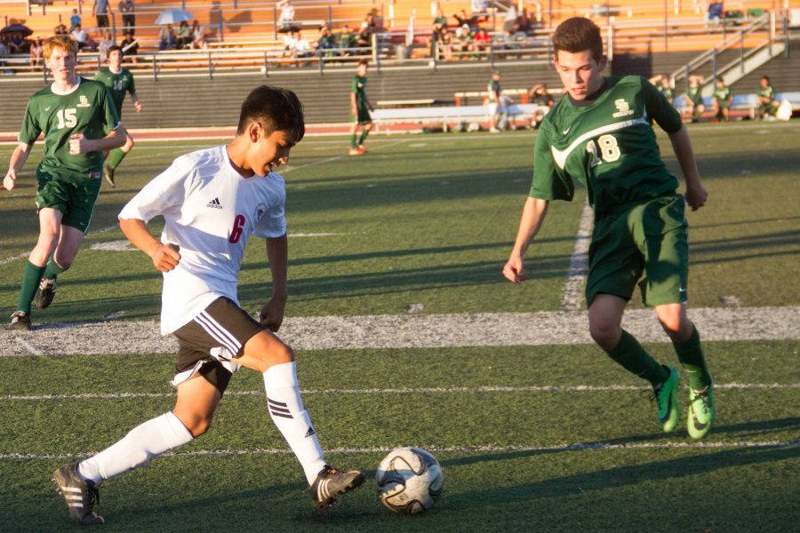 Junior Andres Coronel held possession of the ball for the Foothill team for a large portion of the match. Credit: Chloey Settles/The Foothill Dragon Press