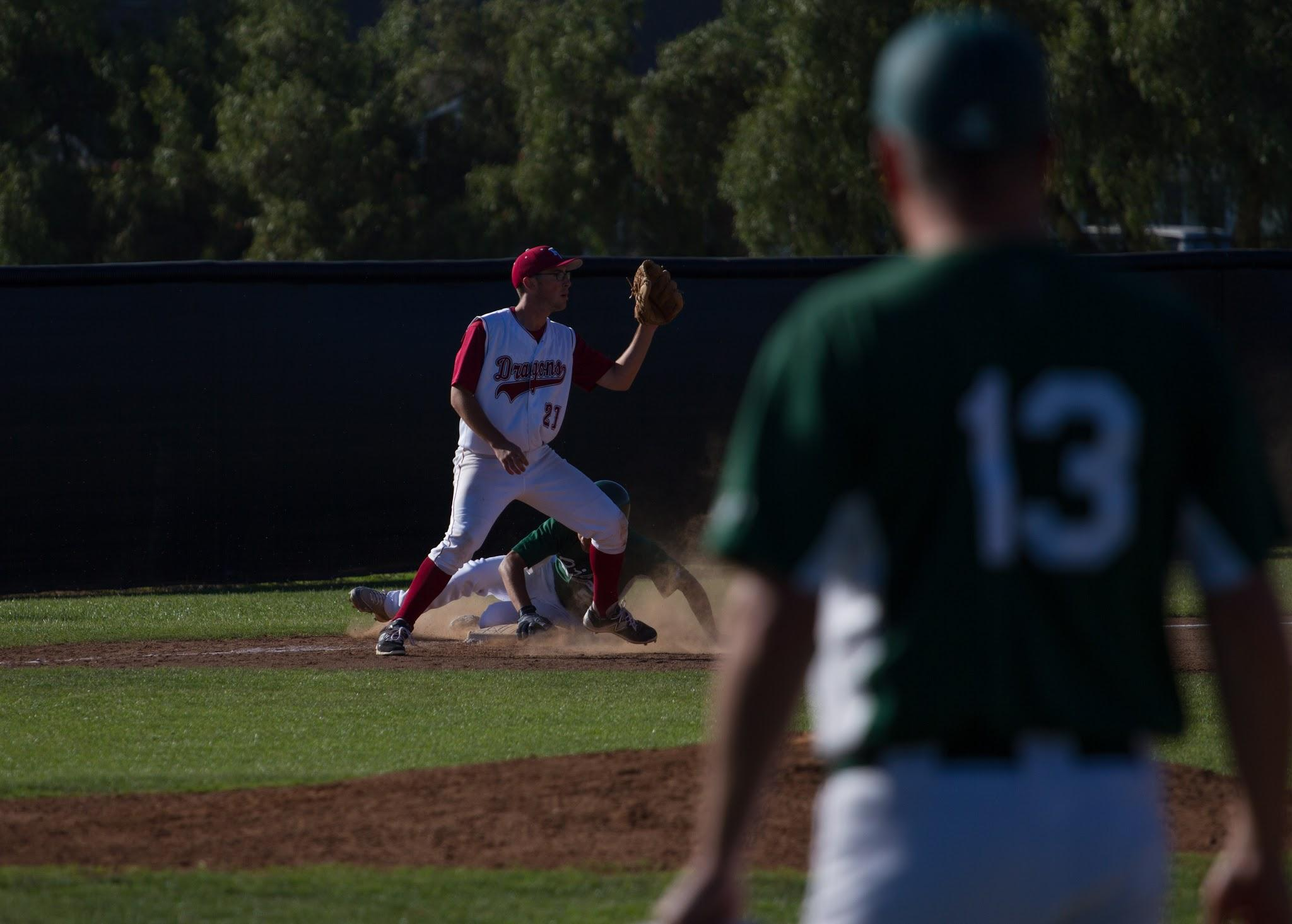 Junior Alex Beamer attempts to get the opposing player out at third base. Credit: Austin Hunt/ The Foothill Dragon Press