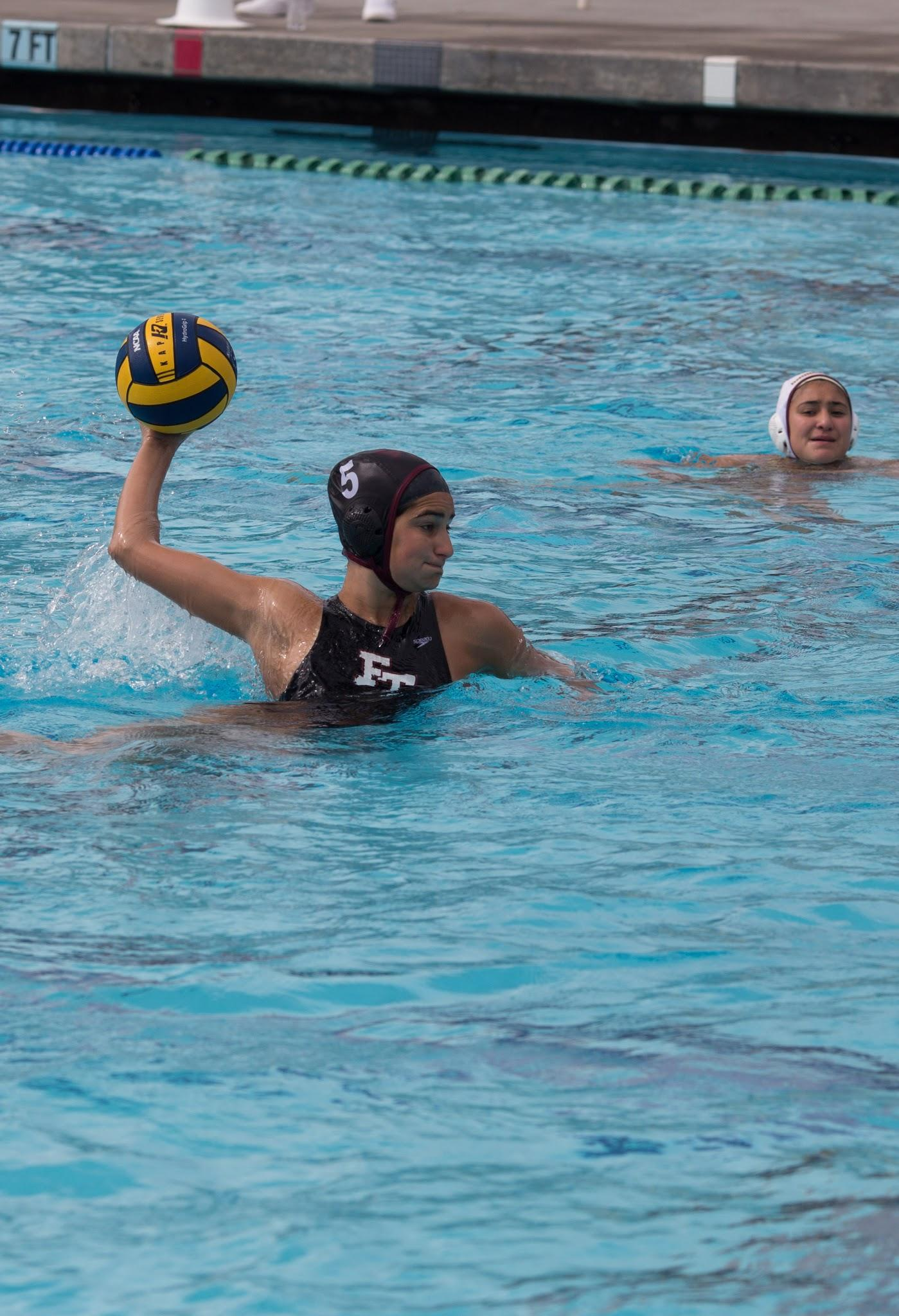 Senior and MVP of the year Ariana Singer playing at a water polo game. Credit: Kazu Koba/The Foothill Dragon Press