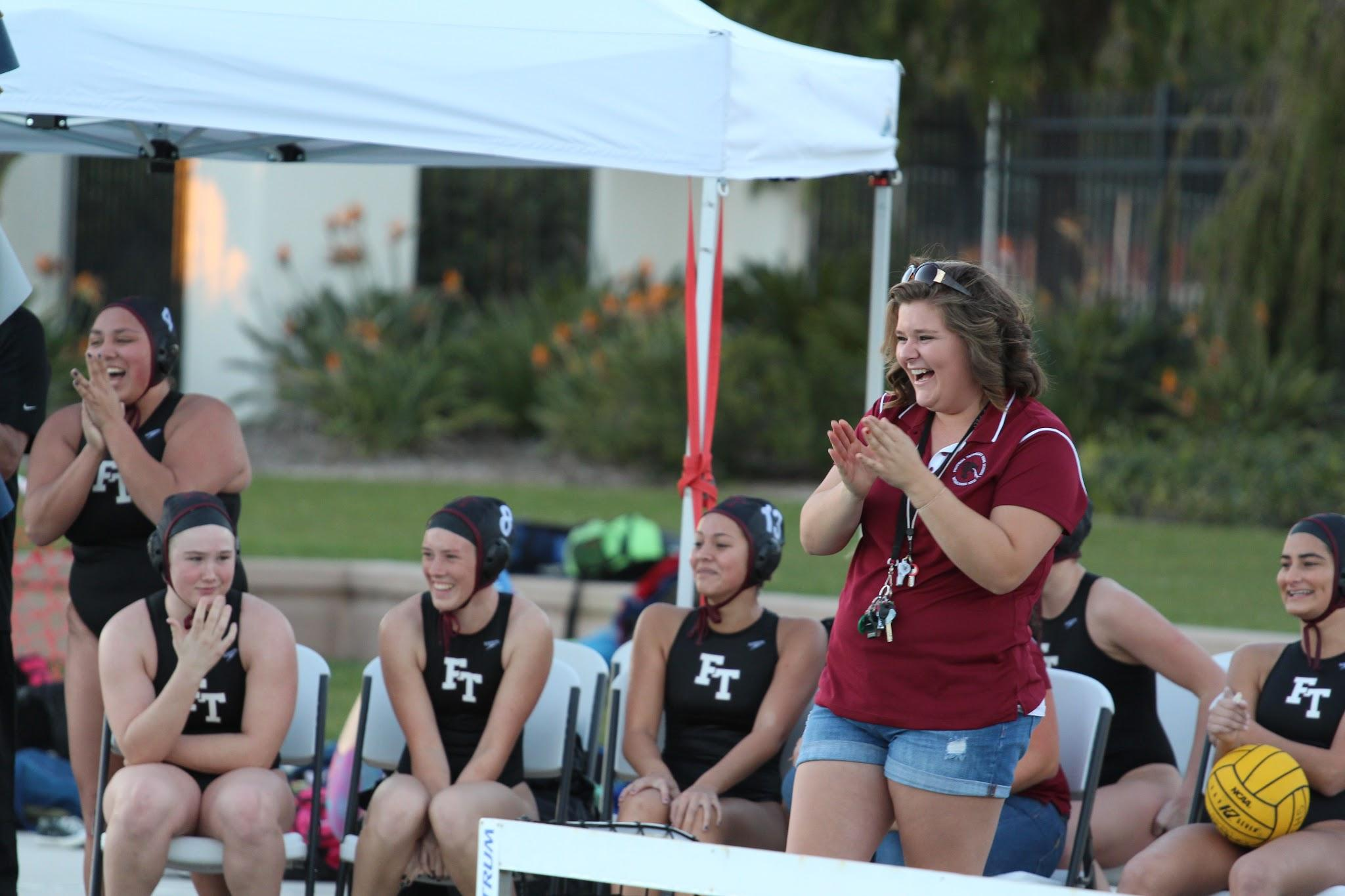 Coach Samantha Eberson at a game cheering her team on. Credit: Kazu Koba/The Foothill Dragon Press