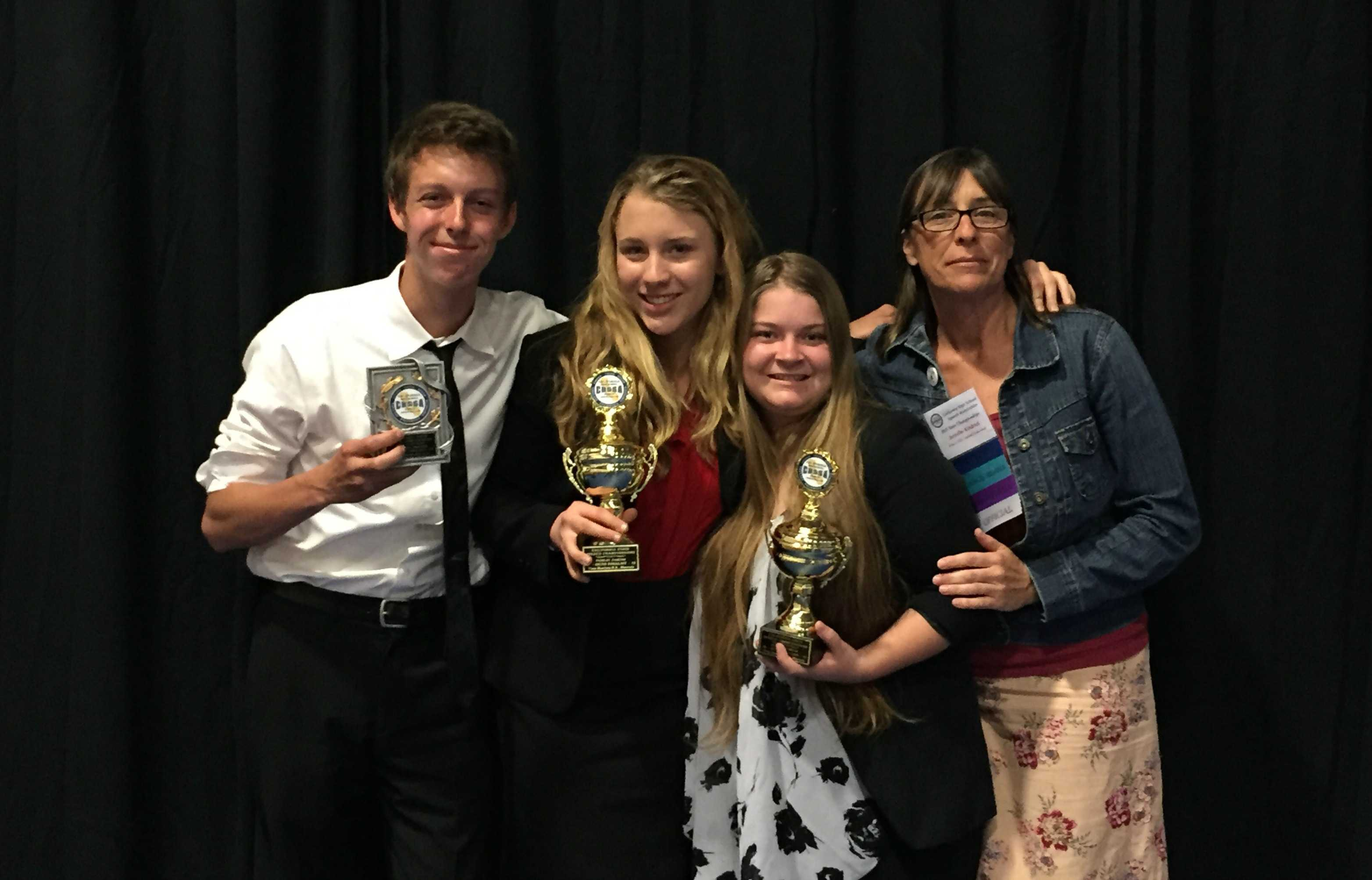 (From left to right) Senior Ben Limpich, junior Fidelity Ballmer, junior Khaila Hartung-Dallas and Speech and Debate coach Jennifer Kindred all went to the state tournament at Murrieta High School. Photo courtesy of Jennifer Kindred.