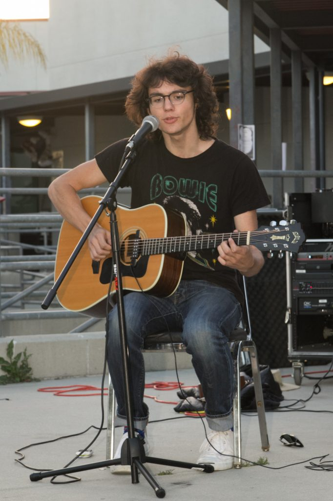 Senior Wyatt Kufta-Kuntz performed a guitar and singing solo as the last act. Credit: Josh Ren/The Foothill Dragon Press