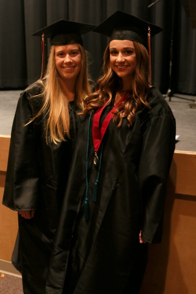 Torie Dawson (left) and Cassidy Bouchard (right) wore their gowns during the evening because they won't be able to attend graduation. Credit: Joel Mayorga/The Foothill Dragon Press