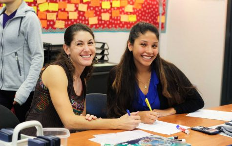Math teacher Rita Batch working on math problems with senior Jazmin Reyes. Credit: Josh Ren/The Foothill Dragon Press