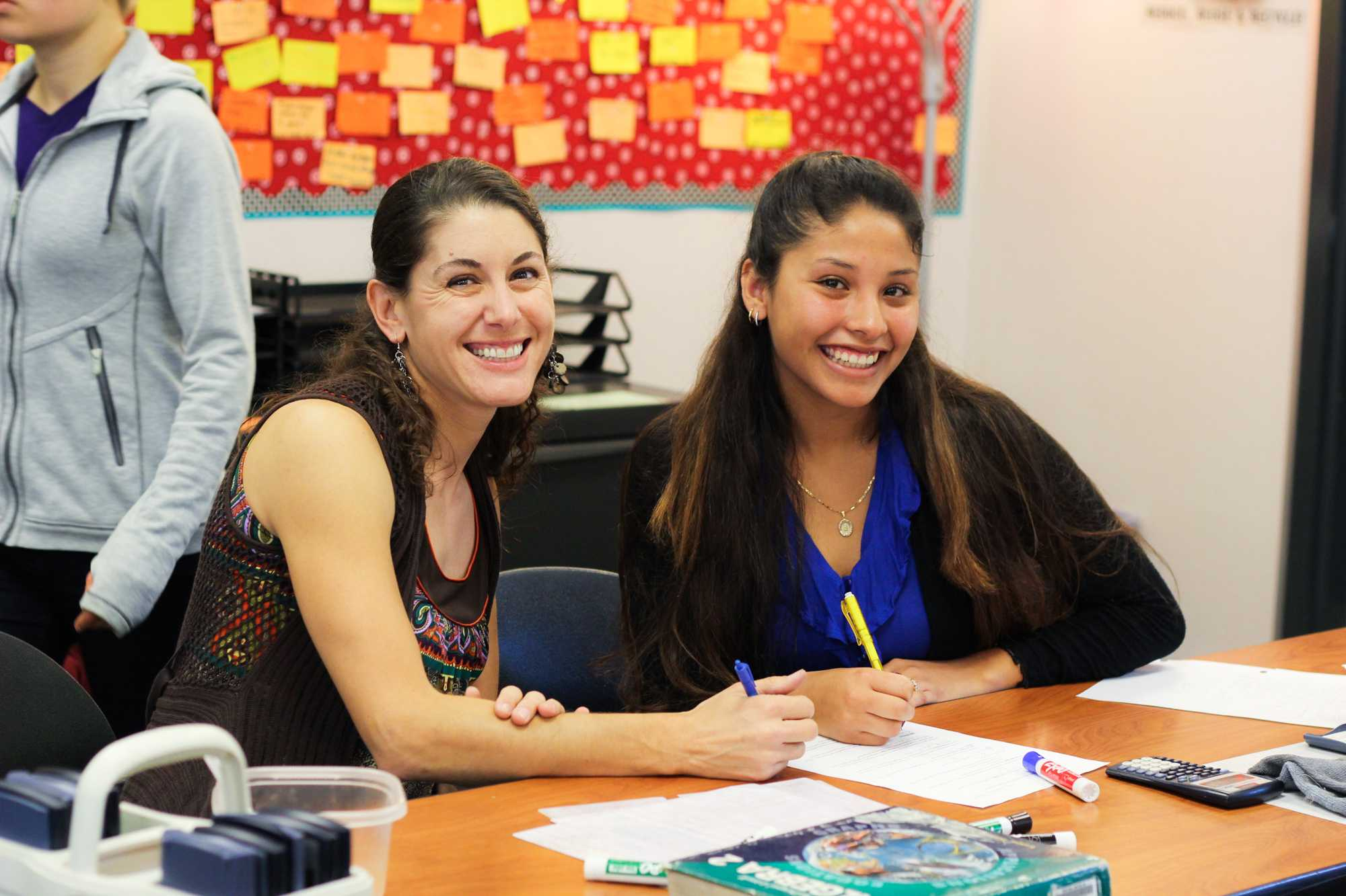 Math teacher Rita Batch working on math problems with senior Jazmin Reyes. Credit: Josh Ren/The Foothill Dragon Press