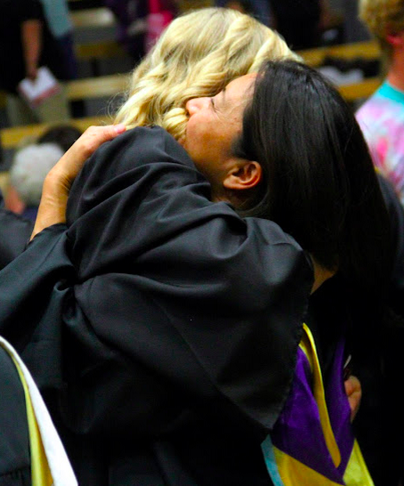 Science teacher Mika Anderson hugs a senior goodbye. Credit: Rachel Horiuchi/The Foothill Dragon Press