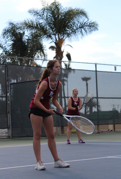 Doubles team Karina Cole and Emma Kolesnik prepare to return the serve. Credit: Carrie Coonan/The Foothill Dragon Press