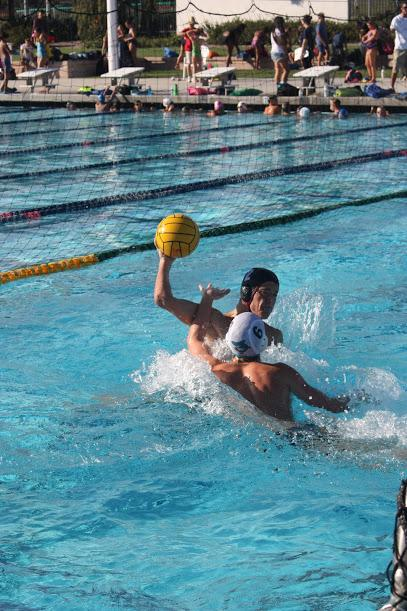 Junior Kevin Waechter defends the ball while also attempting a shot.  Credit: Gabrialla Cockerell/The Foothill Dragon Press