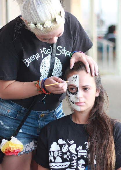 A participant receives a skull face painting at Wednesday's El Dia de los Muertos (The Day of the Dead) celebration at Buena High School.  Credit: Grayson McCoy/The Foothill Dragon Press