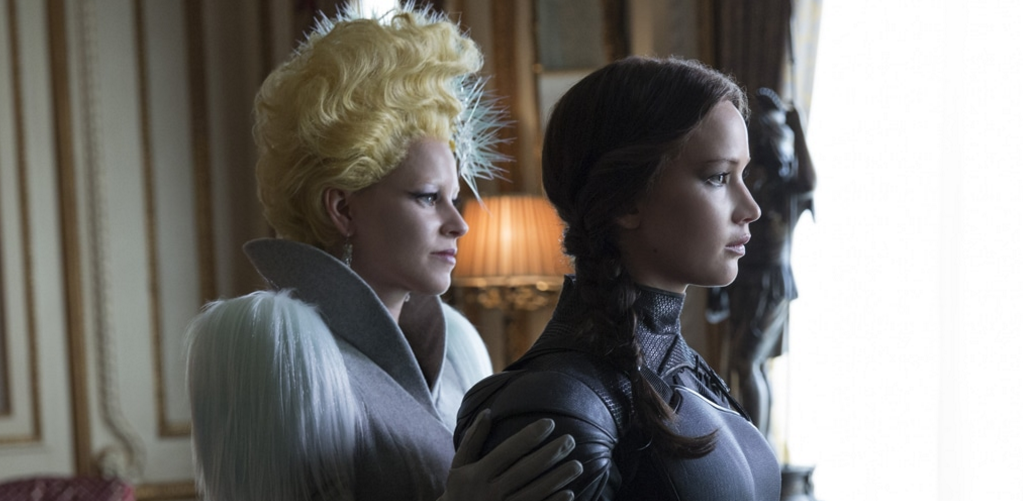 Effie Trinket (Elizabeth Banks, left) and Katniss Everdeen (Jennifer Lawrence, right) in The Hunger Games: Mockingjay- Part 2. Credit: Murray Close