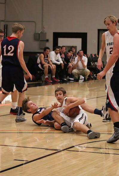 Sophomore Colin Vallance fights to keep the ball from the Providence players. Credit: Grace Carey/The Foothill Dragon Press