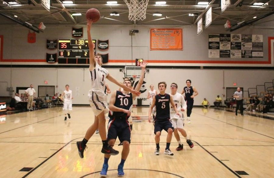Boys' basketball falls to Providence High School 44-50 in first home game of the season