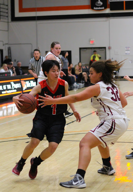Sophomore Ze'le Sparks attempts to hinder a Grace Brethren player during the FTHS girls' basketball first home game on Tuesday night. Credit: Sarah Kagan/The Foothill Dragon Press