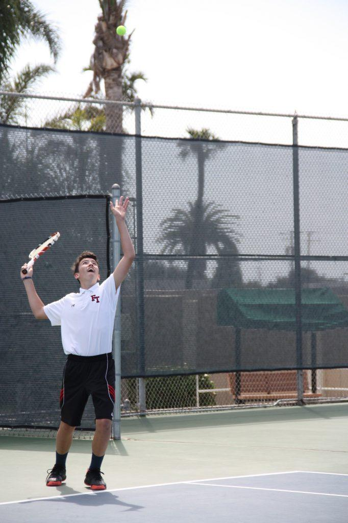 Freshman Kaylan Ouerbacker serves during his double match with Austin Gama. Photo Credit: Gabrialla Cockerell / The Foothill Dragon Press