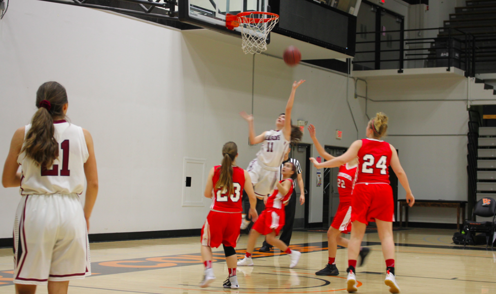 Girls' basketball wins handily in first home game of the season
