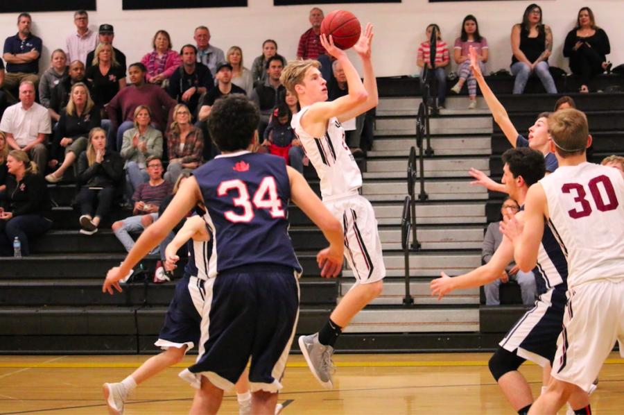 Boys' basketball rolls over Pilgrim 68-35, proceeds to second round