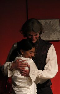 Chris Clark '17 and Cayla Clark '18 'embrace' their roles onstage. Credit: Carrie Coonan / The Foothill Dragon Press