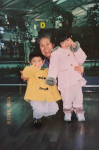 Sowon Lee (left) with her younger brother and grandmother at airport in South Korea before leaving for California for the first time. Credit: Sowon Lee (Used with permission)