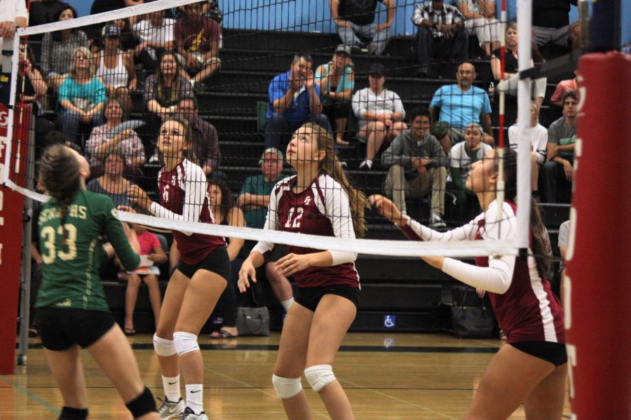 Angel Esparza '20, Techelle Pagan '18 and Haley Higgins '19 focus on the ball as the Seraphs prepare to hit it over the net. Credit: Jason Messner / The Foothill Dragon Press