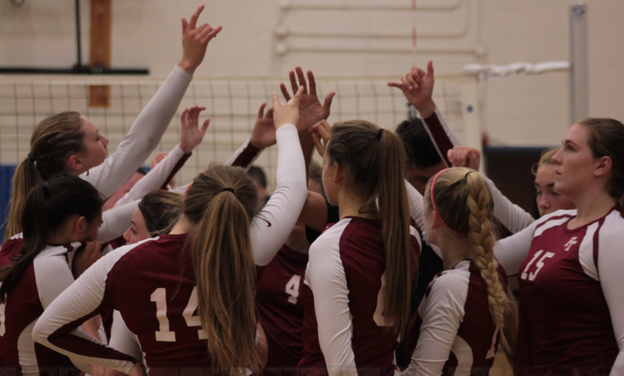 FTHS' team cheers before getting ready to go back out on the court. Credit: Jason Messner / The Foothill Dragon Press