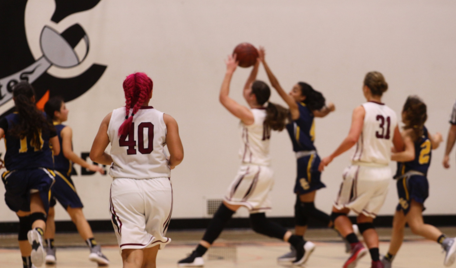 Girls' basketball snares win over Saints in first home game of season