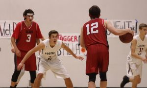 Boys', girls' basketball both fall in final round; place second in respective division